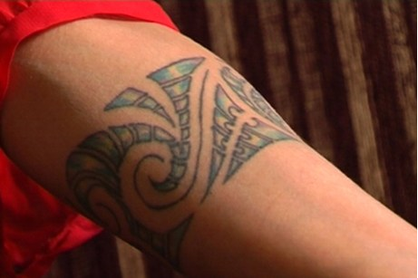 Air New Zealand says many travellers are frightened and intimidated by tattoos.