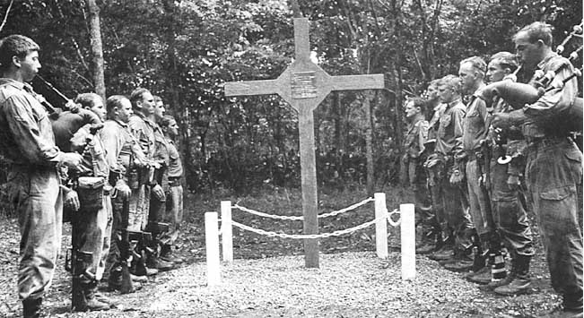 The Long Tan Cross – one of only two such crosses allowed in Vietnam To commemorate the acts of bravery of 107 (Photo: The Piper's Lament, dedication of the battlefield memorial, the Long Tan Cross, 18 August 1969, to those who died in the Battle of Long Tan, 18 August 1966. [AWM negative BEL/69/0556/VN]