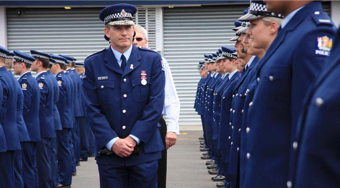 Waitamata police districts superintendent Bill Searle -trying real hard to conceal his obvious pleasure with some of the talent amongst the ranks, especially the blond chick right foreground.