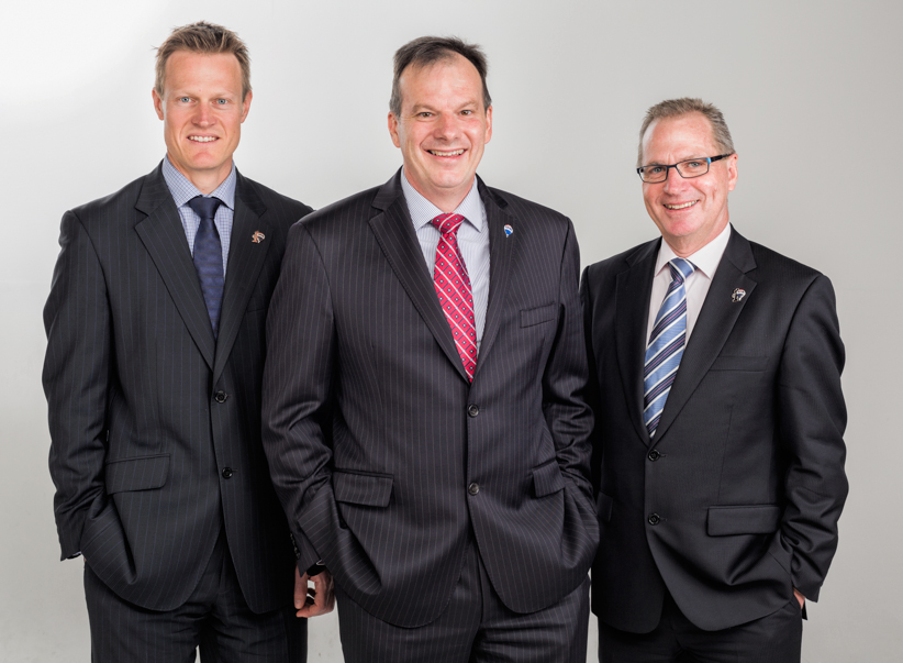 The entre-manure-al RE/MAX management team, headed up by none other than