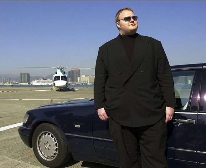 Police justifications for using anti-terrorist officers to raid Kim Dotcom's home were partly based on claims the tycoon assaulted a former staff member with his stomach.