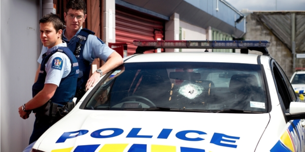 Constables Nick Frederick (left) and Mike Nolan had to face down an armed man in Auckland on Sunday, their guns still in the car which was shot at. Photo / Dean Purcell