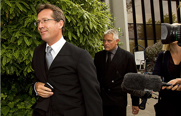CORRUPT COP: Gordon Stanley Meyer, 45, follows his lawyer Jonathan Eaton outside the High Court in Christchurch, where he admitted charges of corruption and bribery